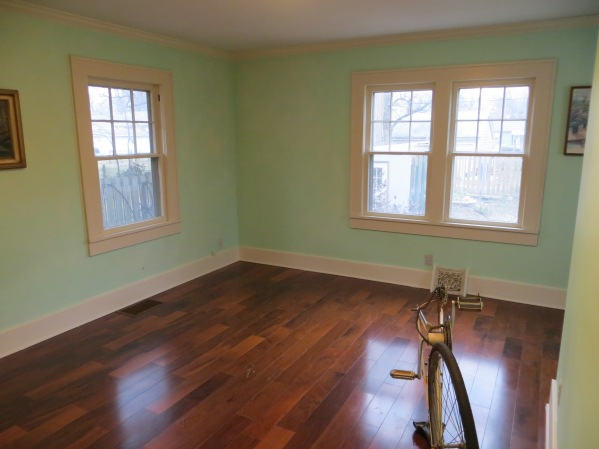 Pre reno master bedroom with light turquoise paint