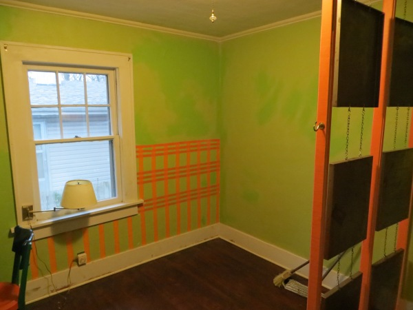 Pre reno lime green paint with orange stenciling and crazy art installation