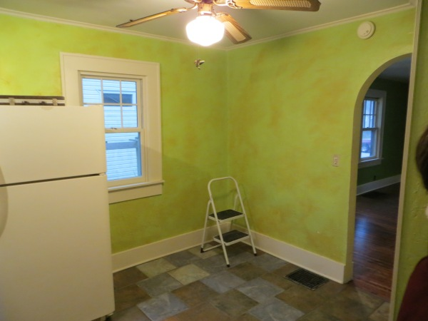 Green kitchen with sponge painting before pass through was installed