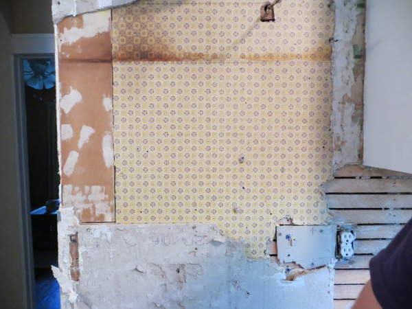 Uncovered vintage wallpaper in kitchen