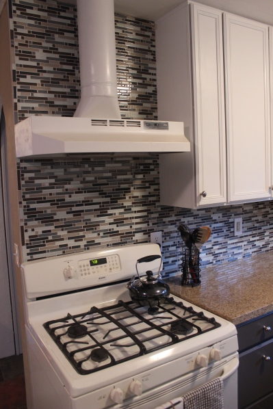 Blue, gray and brown glass mosaic tile back splash