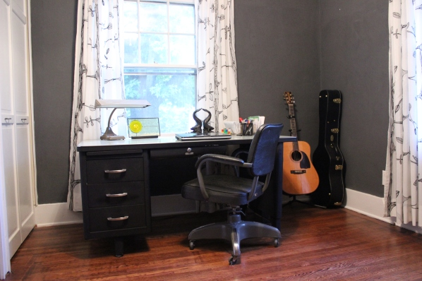 Gray paint, industrial desk, Ikea curtains