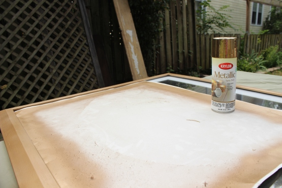 Gold metallic Krylon spray paint on a large picture frame