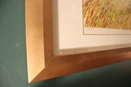 Close up of gold spray painted picture frame