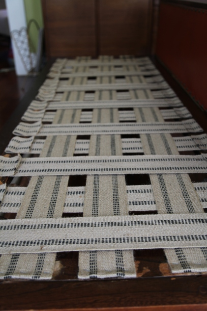 Weaving new webbing on a wooden couch frame