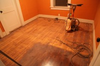 Refinishing old wood floors with a buff sander
