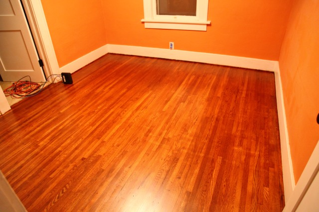 Newly refinished wood floors in a bungalow