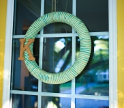 Striped yarn wreath with cork letter