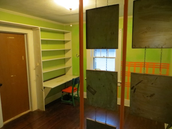 Before our reno. Lime green room with wood and metal room divider.
