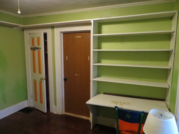 Before our redo. Built on desk and shelving.