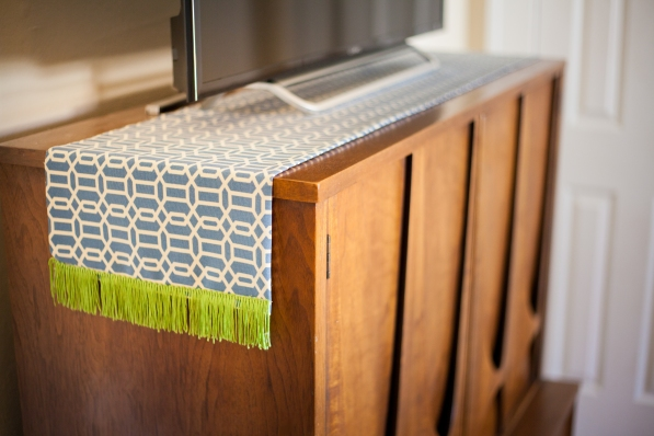 Broyhill Brasilia chest with colorful fringed runner.