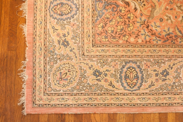 Pink, yellow, and blue vintage Oriental rug
