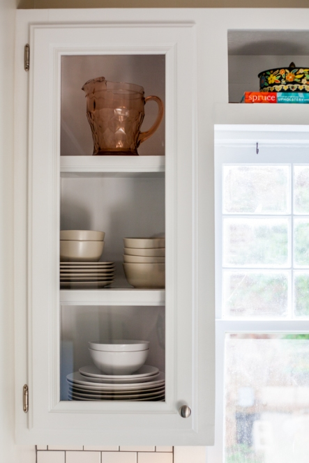 Glass front cabinets. Displaying dishes in open cabinets.