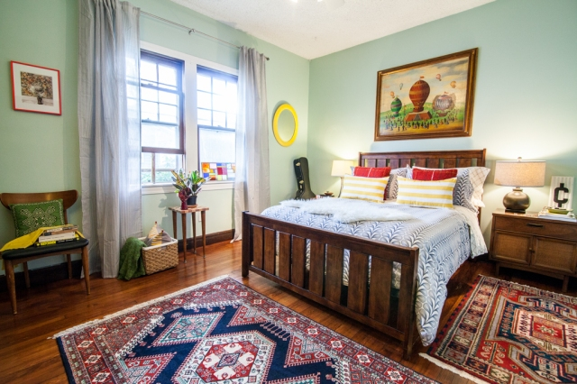 Bright blue bedroom. Mixing rugs. Eclectic vintage style.