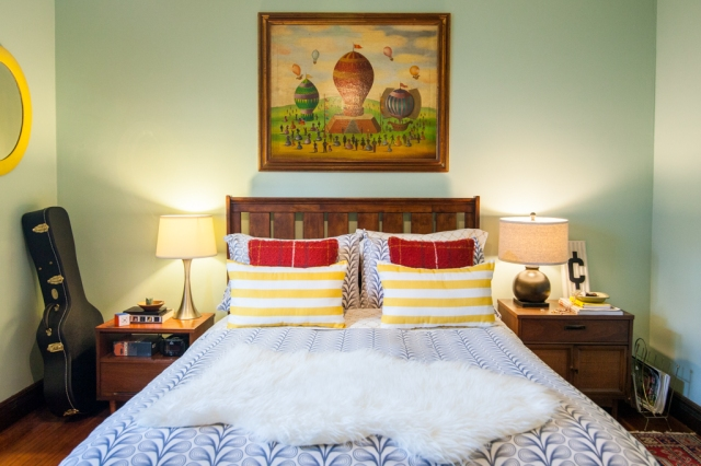 Hanging large art above the bed.