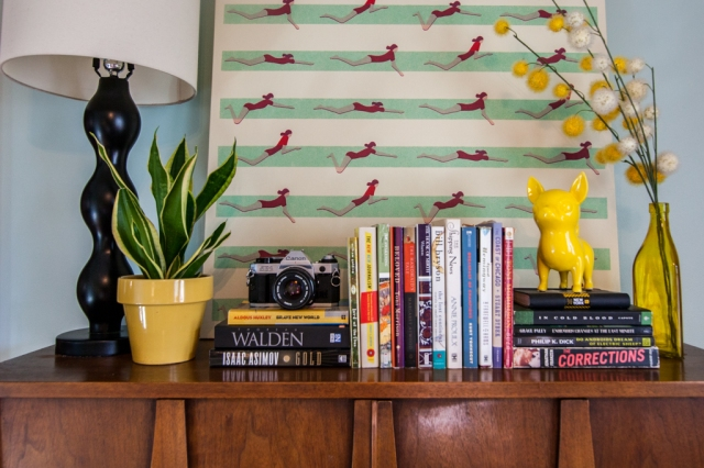 Bookshelf styling. Yellow decor.