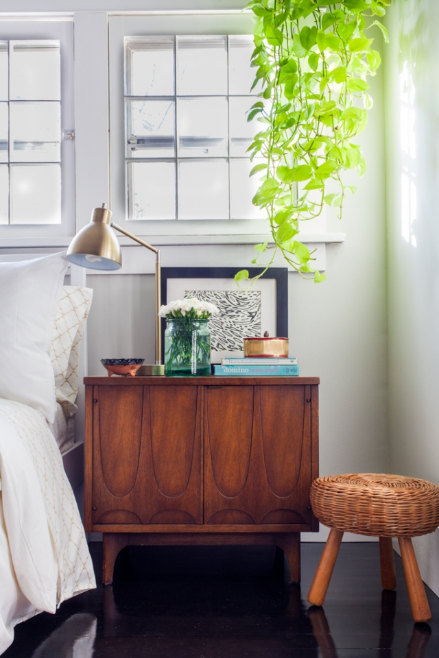 Vintage eclectic nightstand styling.
