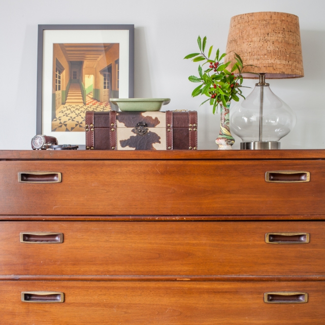 Vintage inspired dresser styling with masculine elements.